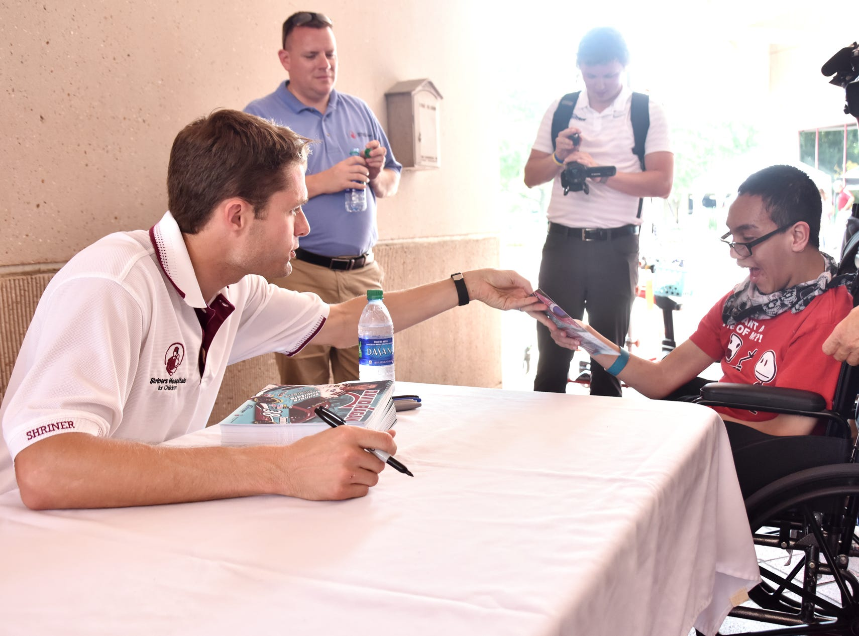 NASCAR driver David Ragan signs autographs at the Shriners Hospital for Children in Greenville on August 15, 2018.