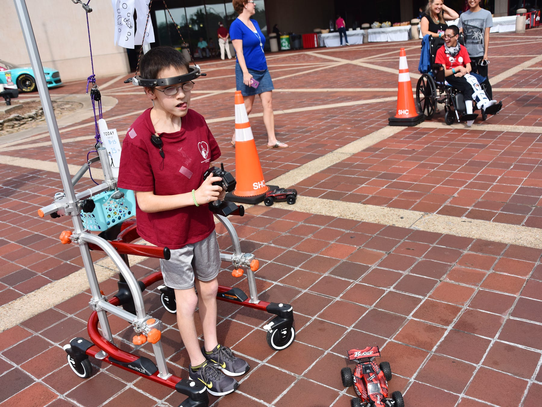 Grayson Lusk, 11, plays with a remote control car at the Shriners Hosptial for Children in Greenville on August 15, 2018.