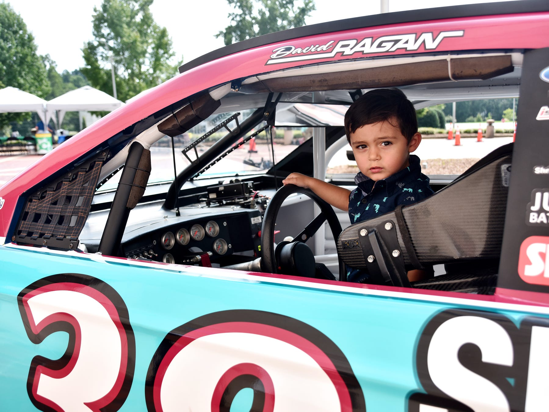 Ethan Horseman 2, sits inside a race car at the Shriners Hospital for Children on August 15, 2018.