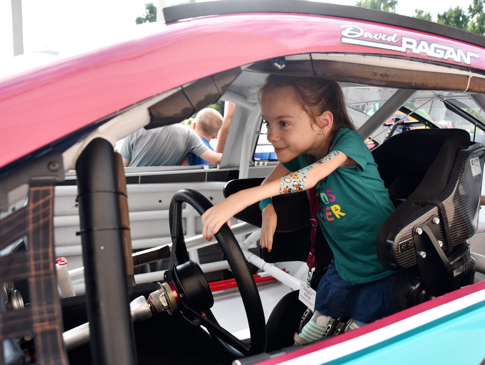 Brayden Dame, 7, sits inside a race car at the Shriners Hospital for Children on August 15, 2018.