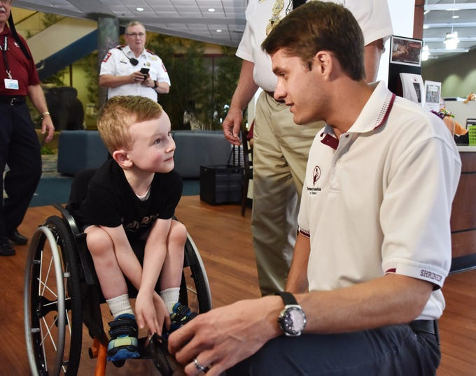 Wyatt Banks, 5, talks with NASCAR driver and Shriner David Raga at the Shriners Hosptial for Children in Greenville on August 15, 2018.