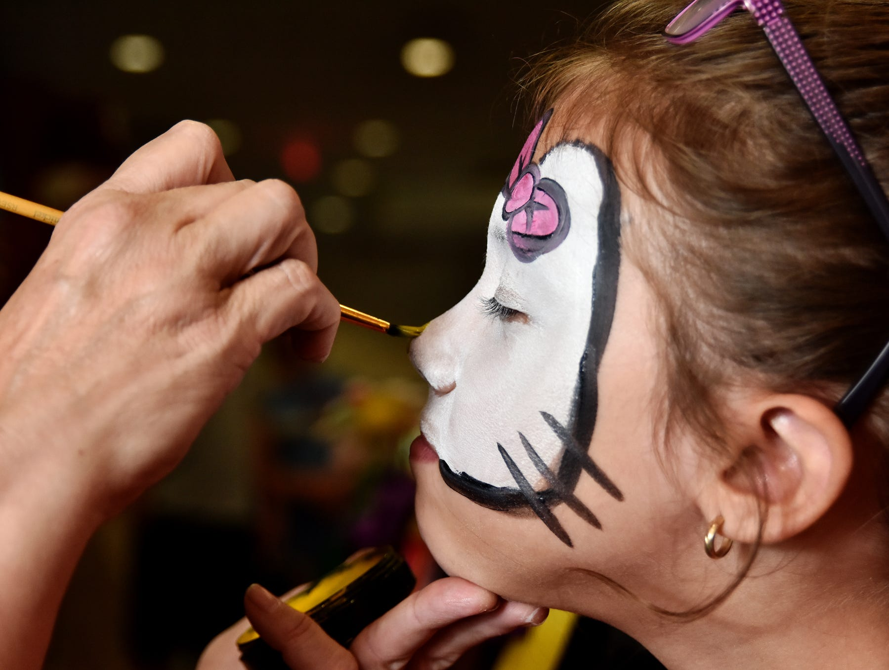 Ellie Barbour, 8, has her face painted at the Shriners Hospital for Children in Greenville on August 15, 2018.