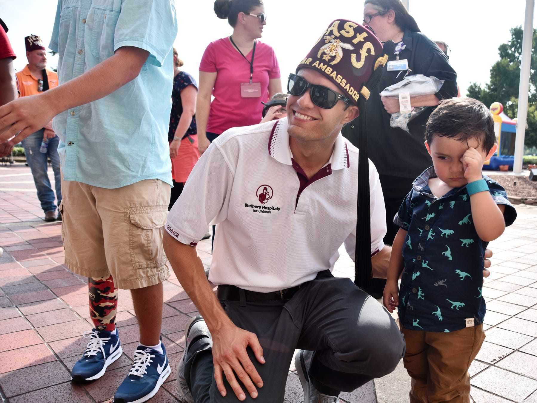 NASCAR driver David Ragan poses for a photo with Ethan Horseman, 2, at the  Shriners Hospital for Children in Greenville on August 15, 2018.