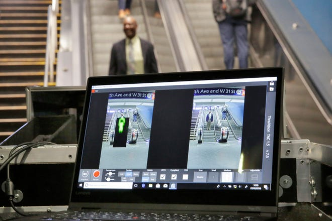 In this Tuesday, Feb. 27, 2018 file photo, ThruVision suicide vest-detection technology reveals a suspicious object on a man, at left, during a Transportation Security Administration demonstration in New York's Penn Station. Los Angeles is poised to have the first mass transit system in the U.S. with body scanners that screen passengers for weapons and explosives.