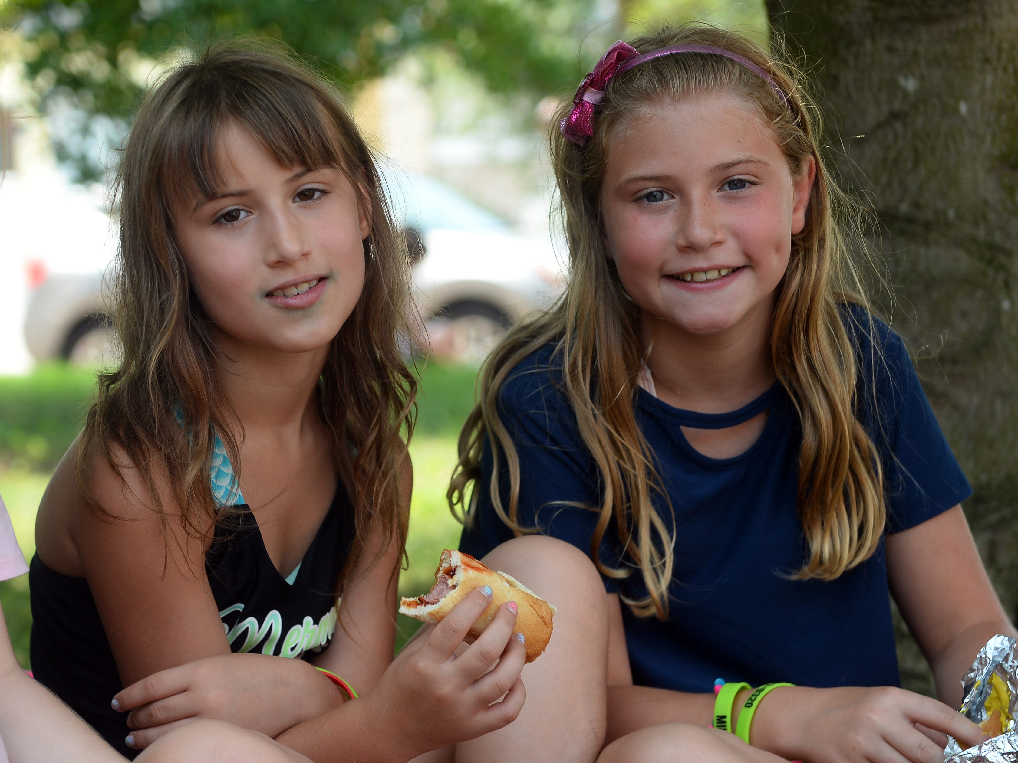 Children enjoy a free lunch during Millville's Play Streets event on Wednesday, August 15.
