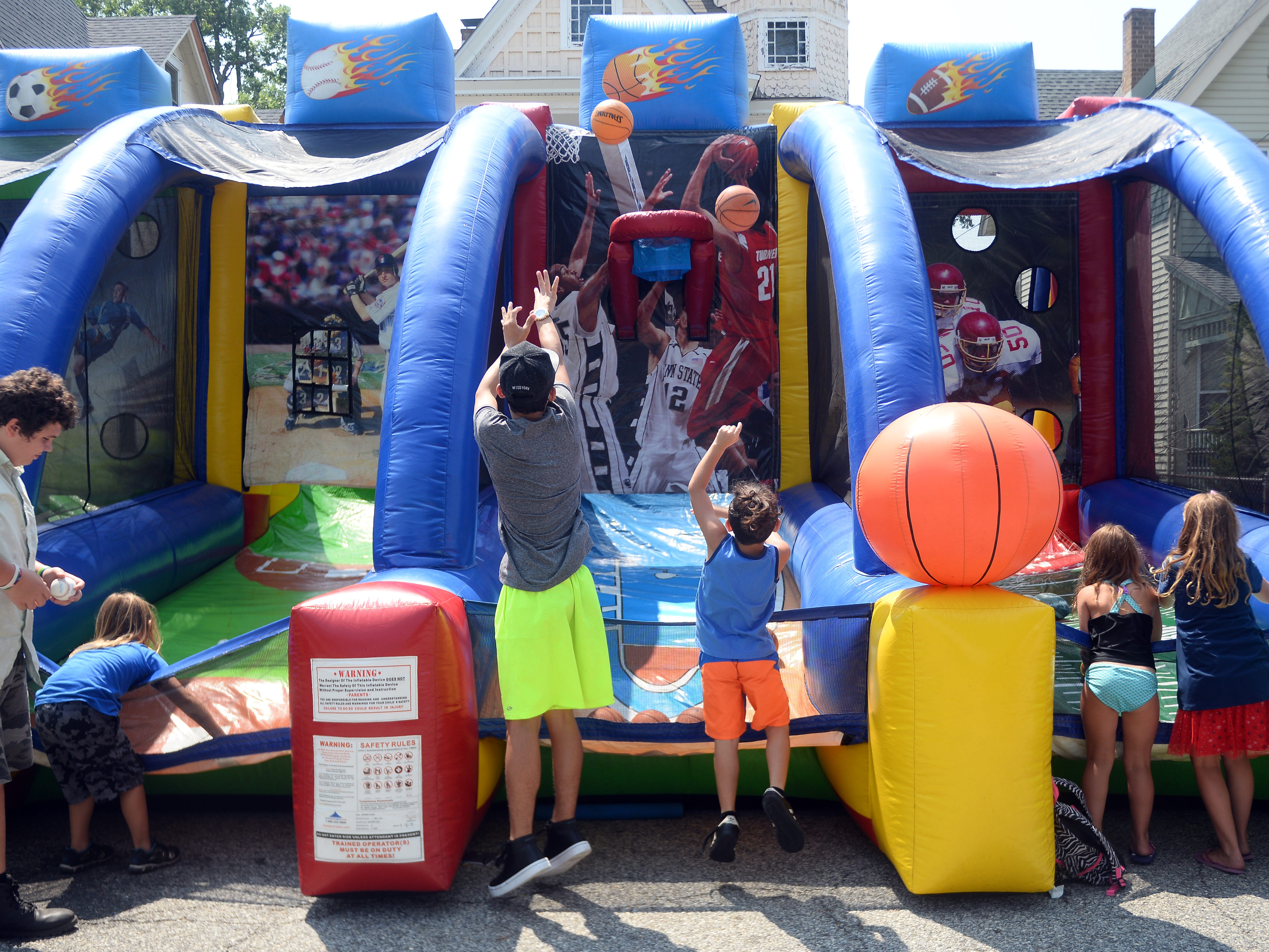Kids enjoy one last Play Streets before heading back to school. The weekly summer function is hosted by the Holly City Development Corporation and the city of Millville. The festivities included activities for children and families, lunch and free back packs on Wednesday, August 15.