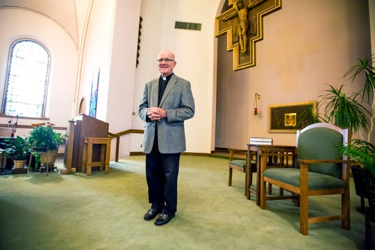 Rev. Dennis Lynch poses for a portrait at Holy Spirit Catholic Church in Stevens Point, Wis., August 15, 2018.