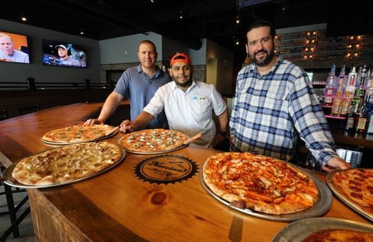 Business partners, Nick Nuccio, Executive Chef Erick Carrasco and Milan Dobrilovic are pictured with some of their pizza pies at Norcina Restaurant at 186 North Main Street in New City. From left, Margherita, Norcina, Eggplant alla Norma, Buffalo Chicken, Pepperoni and the Deep Dish Cheese Steak.