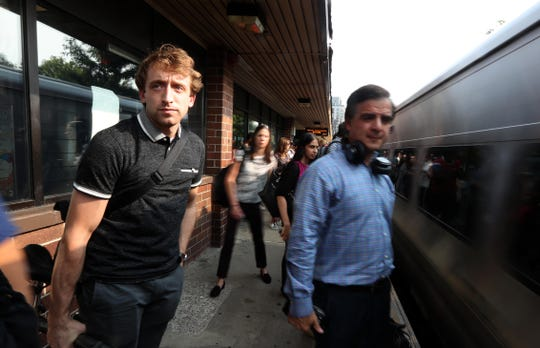 Max Goodstein, 24, left, a landscape architect, stands on the platform at the White Plains Metro-North Station Aug. 15, 2018 as a New York City bound train pulls into the station during the evening commute. Goodstein, originally from Katonah, lives in the Hells Kitchen section of Manhattan. He reverse commutes to his job as a landscape architect in White Plains.