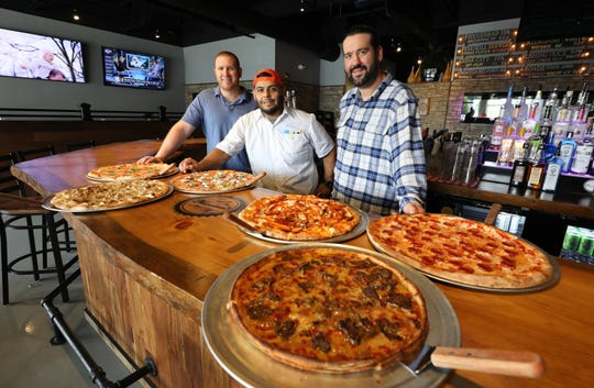 Business partners, Nick Nuccio, Executive Chef Erick Carrasco and Milan Dobrilovic are pictured with some of their pizza pies at Norcina Restaurant at 186 North Main Street in New City, Aug. 15, 2018. They are from left, Margherita, Norcina, Eggplant alla Norma, Buffalo Chicken, Pepperoni and the Deep Dish Cheese Steak.