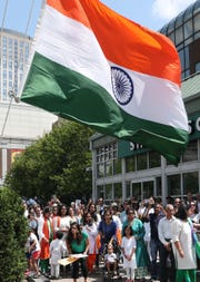 Members of the Indian community sing the Indian National Anthem during the 72nd Independence Day Flag Raising and Celebration at Renaissance Plaza in White Plains Aug. 15, 2018. The event was sponsored by the Indian Cultural Association of North America.