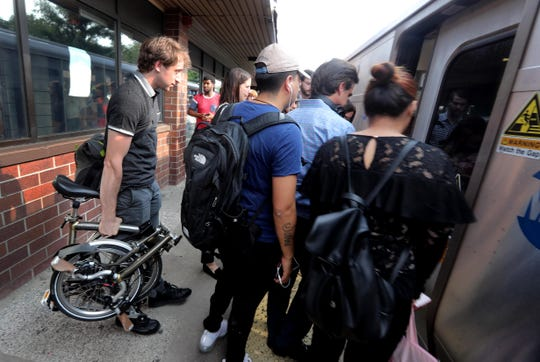 Max Goodstein, 24, left, a landscape architect, boards a New York City bound train during the evening commute at the White Plains Metro-North Station Aug. 15, 2018. Goodstein, originally from Katonah, lives in the Hells Kitchen section of Manhattan. He reverse commutes to his job as a landscape architect in White Plains.