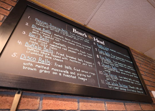 A menu board lists a variety of the 30 meatball sandwiches at B-Balls Meatballs on Prairie Avenue in Suffern, Aug. 15, 2018.