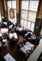 The dining area, with large picture windows, at Red Hat on the River in Irvington, March 13, 2013. ( Mark Vergari/The Journal News )