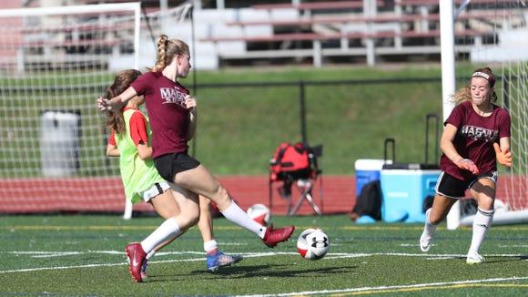 Julianna Hanigan, left, takes a shot on goalkeeper Emma Conlin during practice at Albertus Magnus High School in Bardonia on Wednesday, August 15, 2018.