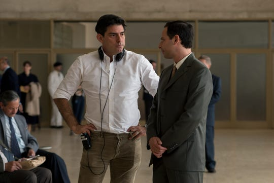 """Director Chris Weitz (left) and actor Nick Kroll (right) on the set of """"Operation Finale,"""" a Metro Goldwyn Mayer Pictures film. Credit: Valeria Florini / Metro Goldwyn Mayer Pictures © 2018 Metro-Goldwyn-Mayer Pictures Inc. All Rights Reserved."""