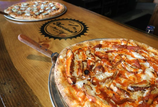 The Buffalo Chcicken Pizza with Cascun Farm chicken and Calabrian chili at Norcina Restaurant at 186 North Main Street in New City, Aug. 15, 2018. In the rear is the Eggplant alla Norma Pizza.