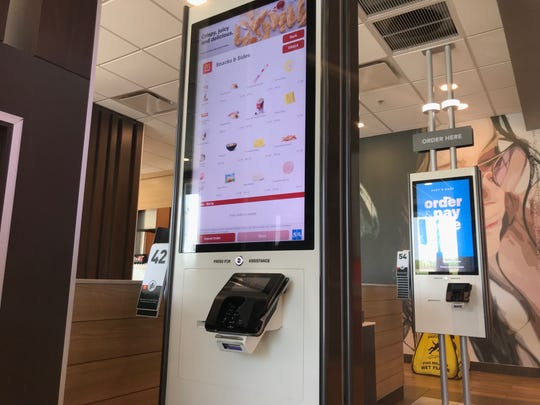 An ordering kiosk at McDonald's on Main Street in Newark. The company and its franchisees are investing money to transform and modernize the company's stores.