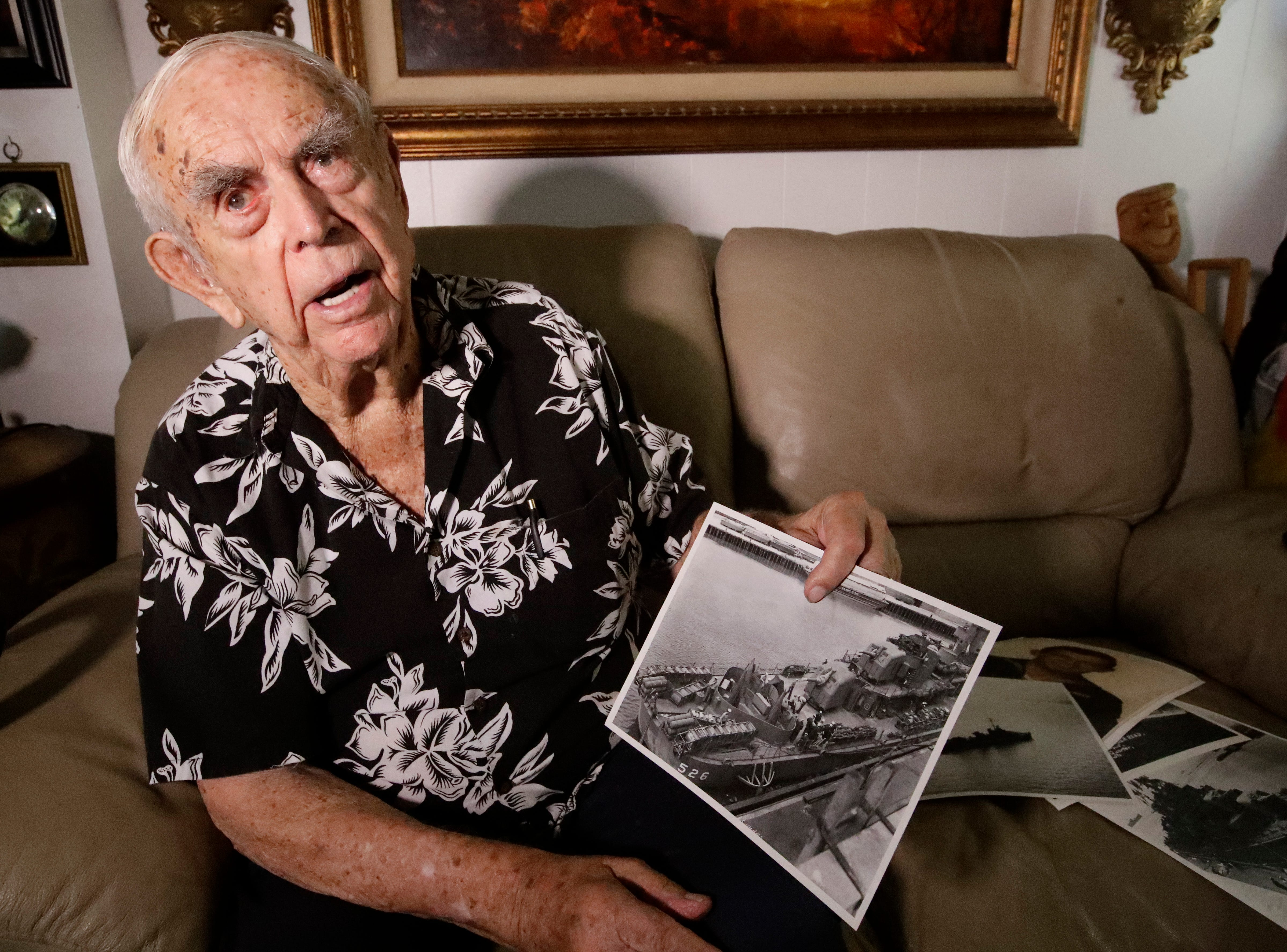 In this Tuesday, Aug. 14, 2018 photo, Daryl Weathers poses for a picture at his home in Seal Beach, Calif. Weathers was aboard the USS Abner Read after it hit a sea mine left by the Japanese after they abandoned Kiska Island in Alaska's Aleutian Islands in 1943. (AP Photo/Chris Carlson)