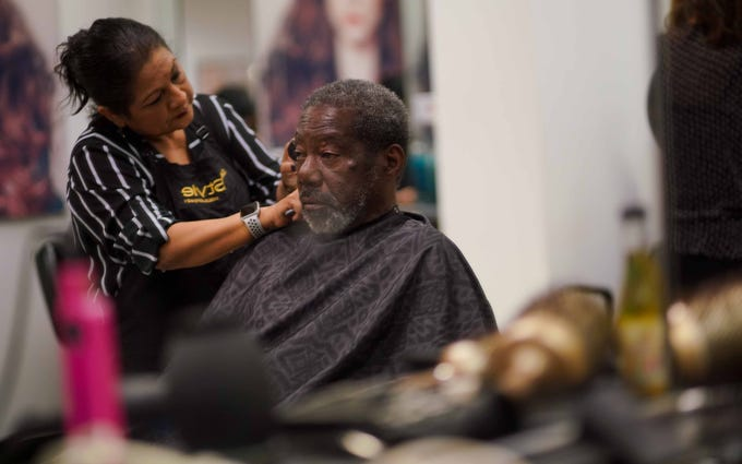 Margarita Reeder, a stylist at the Salon by InStyle Inside JCPenney at the Christiana Mall, trims Andrew Normand's hair during a second annual Makeover Ministry event where stylist and makeup artist for Sephora gave mini makeovers for the homeless community of Wilmington.