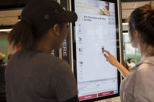 A digital ordering kiosk at McDonald's. The company and its franchisees are investing money to transform and modernize the company's stores.