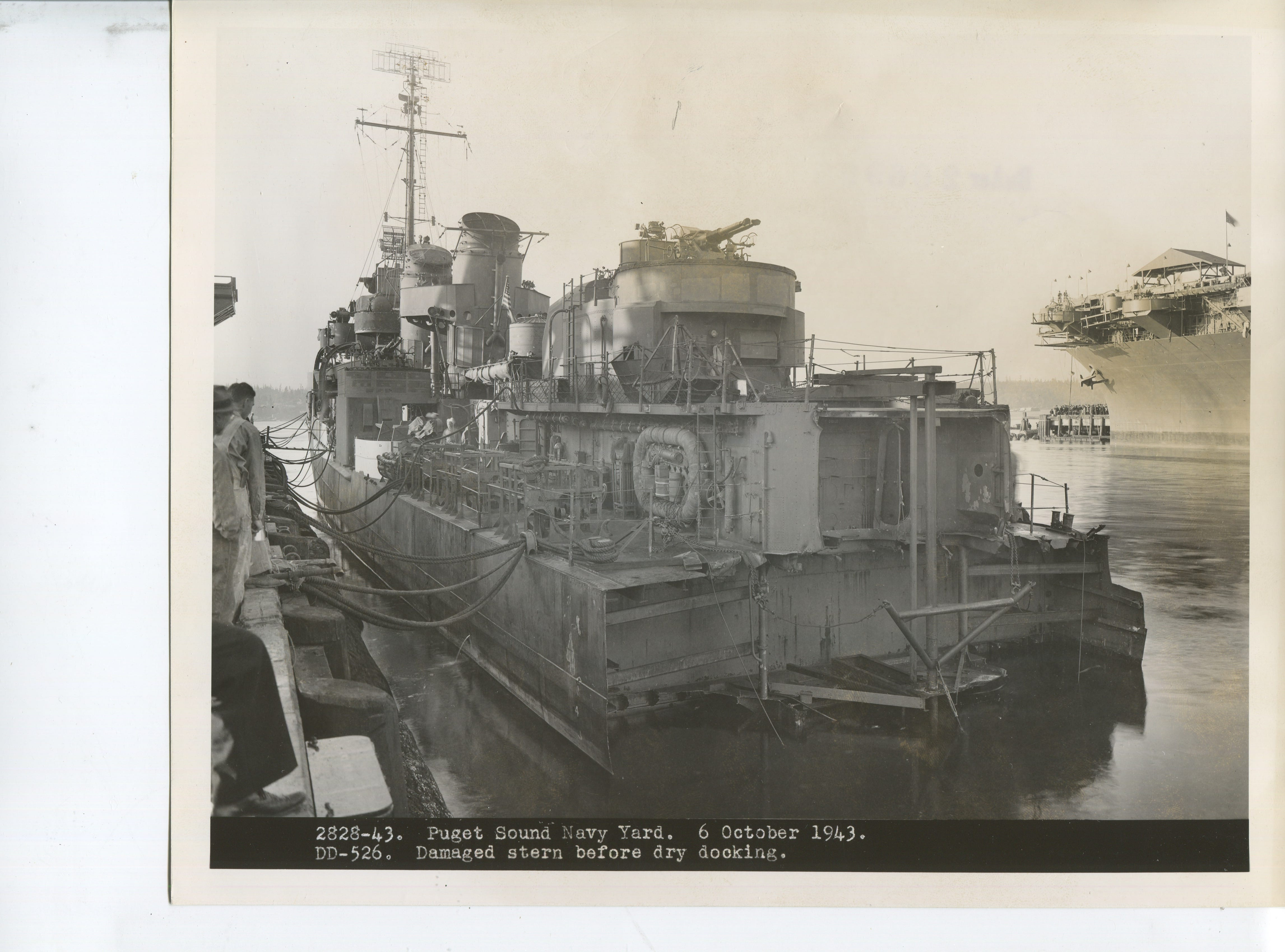 This historical image shows the stern damage to the USS Abner Read before it is dry-docked for repairs in the early 1940s.