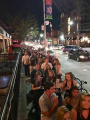 """The line to get into Newark's Catherine Rooney's for a student-filled """"Thirsty Thursday"""" party. Returning students will find the bar has a new owner and a a new name, but the weekly bash will remain."""