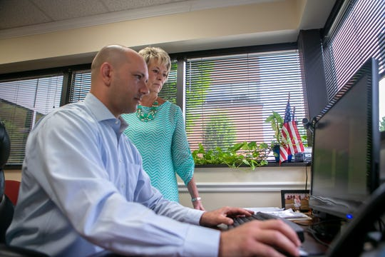 Cheryl Rappucci president of Mortgage Network Solutions and Michael Rappucci work at their office in Wilmington. The company has been chosen as the winner of the Small Company category and the special award for New Ideas. The family run company was founded in 2014 and 35 of their 40 employees are in Delaware.