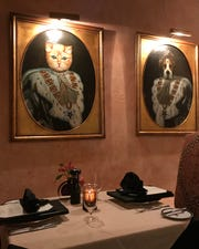 The dining room at Krazy Kat's restaurant at the Inn at Montchanin is decorated with funky animal paintings and prints.