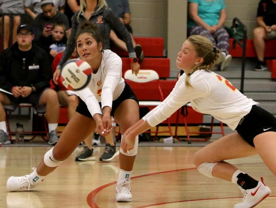 Christ Academy's Kelsey McClellan and Morgan Brasher go for the Boyd serve Tuesday, Aug. 14, 2018, in the Christ Academy gym.