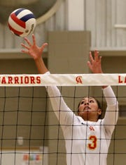 Christ Academy's Kelsey McClellan tries to reach the ball in the match against Boyd Tuesday, Aug. 14, 2018, in the Christ Academy gym.
