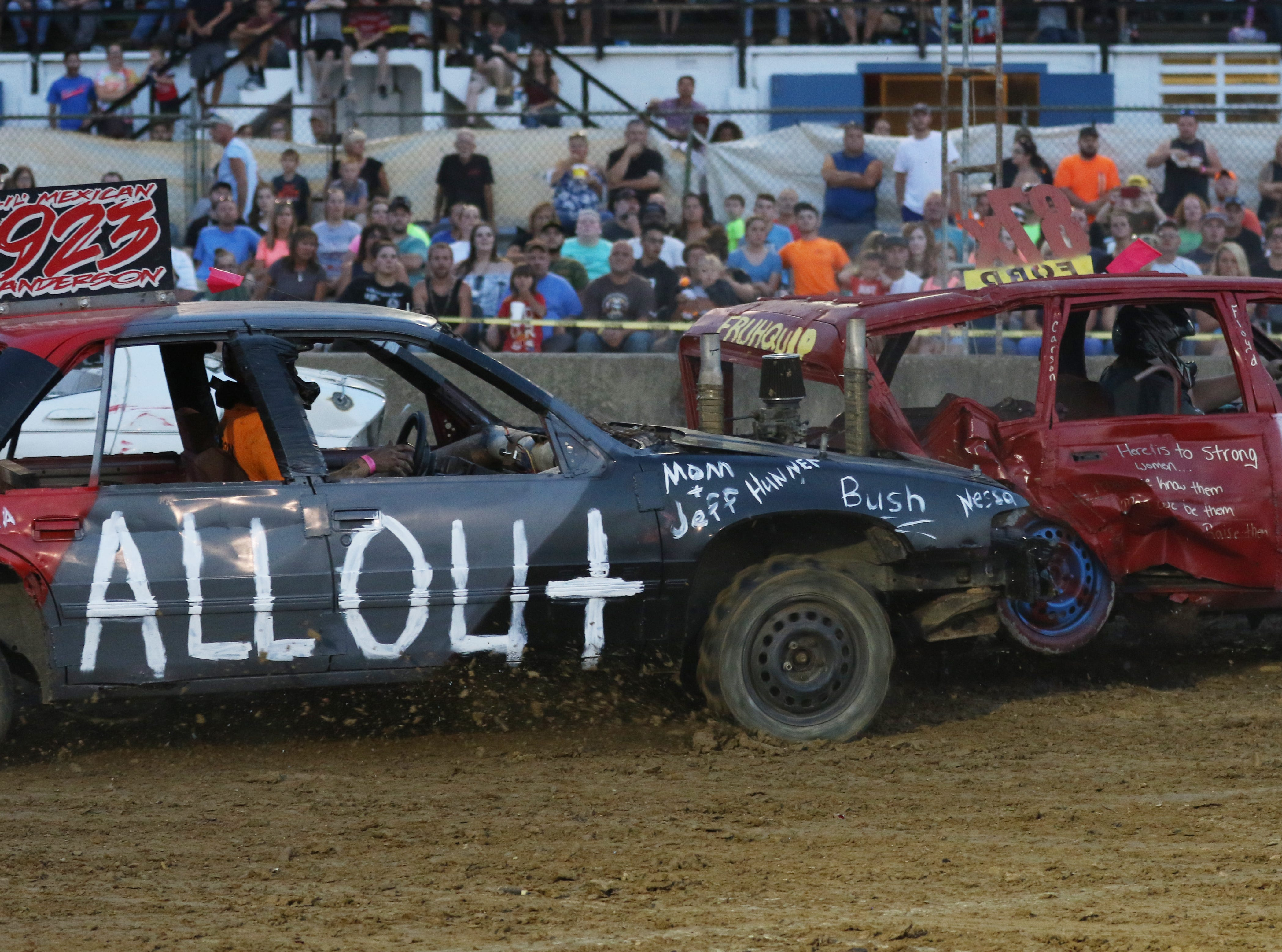 Aaron Anderson hits Rosie Ford during the Sarge and Sons Demolition Derby at the Muskingum County Fair on Tuesday.