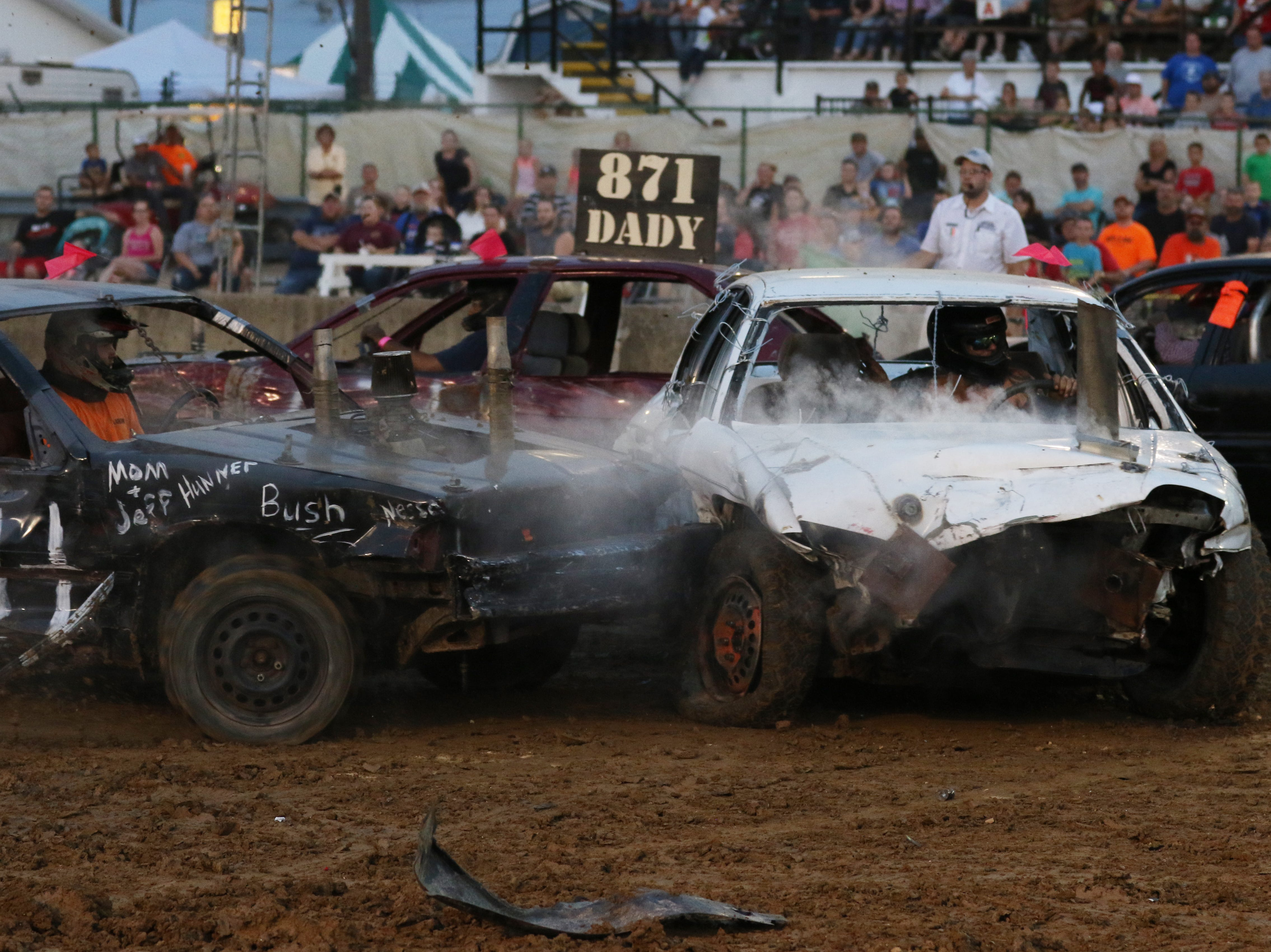 Bobby Gibbons gets hit during the Sarge and Sons Demolition Derby at the Muskingum County Fair on Tuesday.