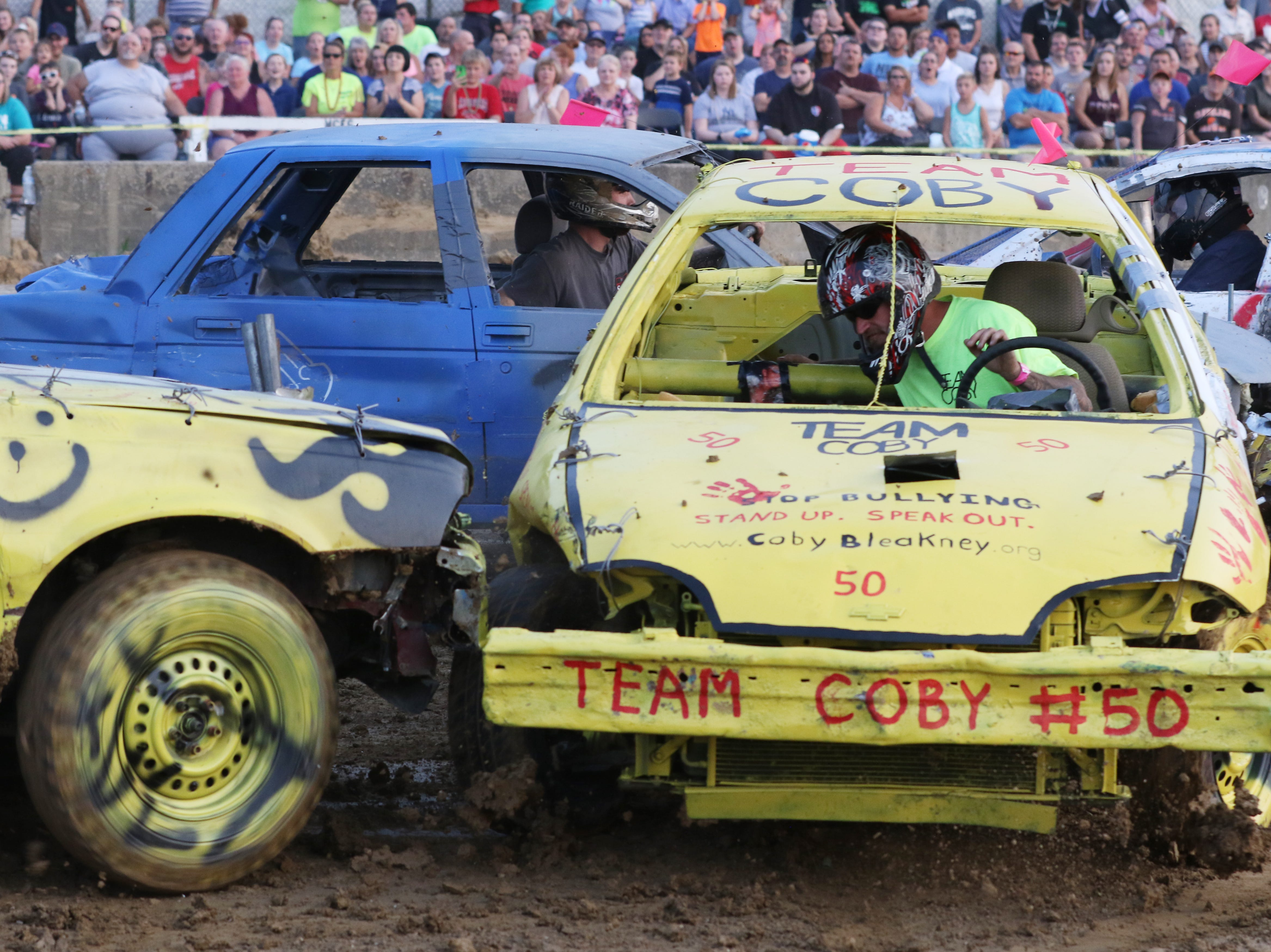 Ronald Miller in his 50 car gets hit during the Sarge and Sons Demolition Derby at the Muskingum County Fair on Tuesday.