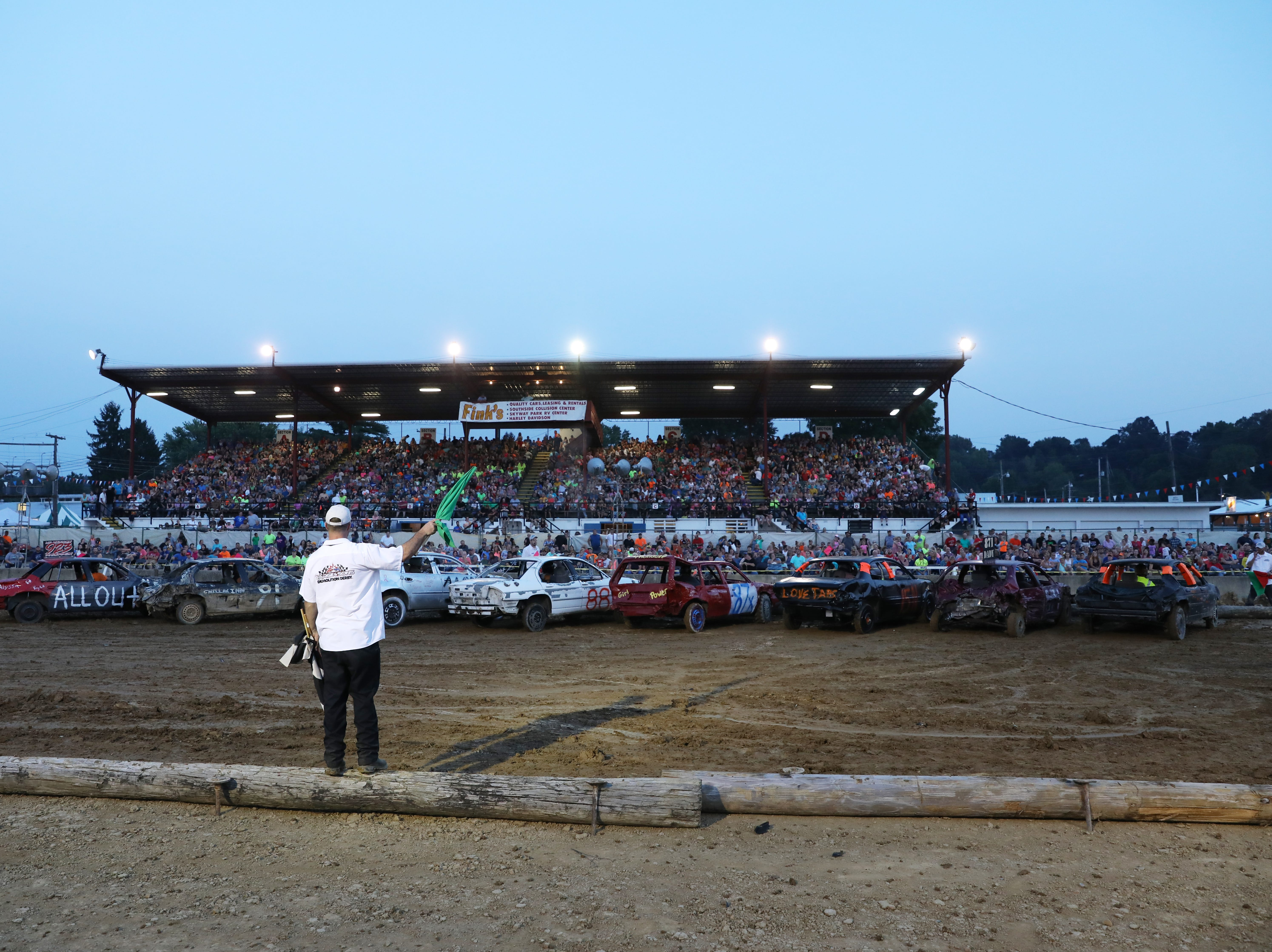 Track officials get the second heat of the Sarge and Sons Demolition Derby started on Tuesday.