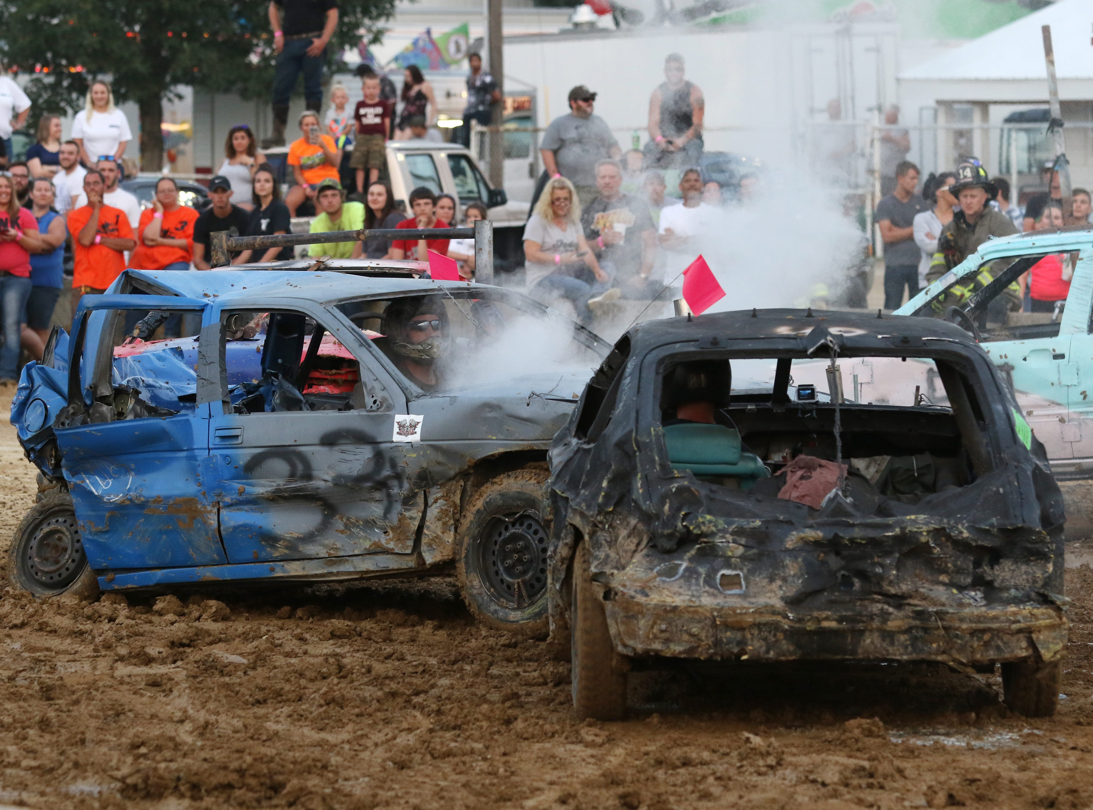 Dusty Dady finishes off the first heat of the Sarge and Sons Demolition Derby at the Muskingum County Fair on Tuesday by taking out Scott Cordle.