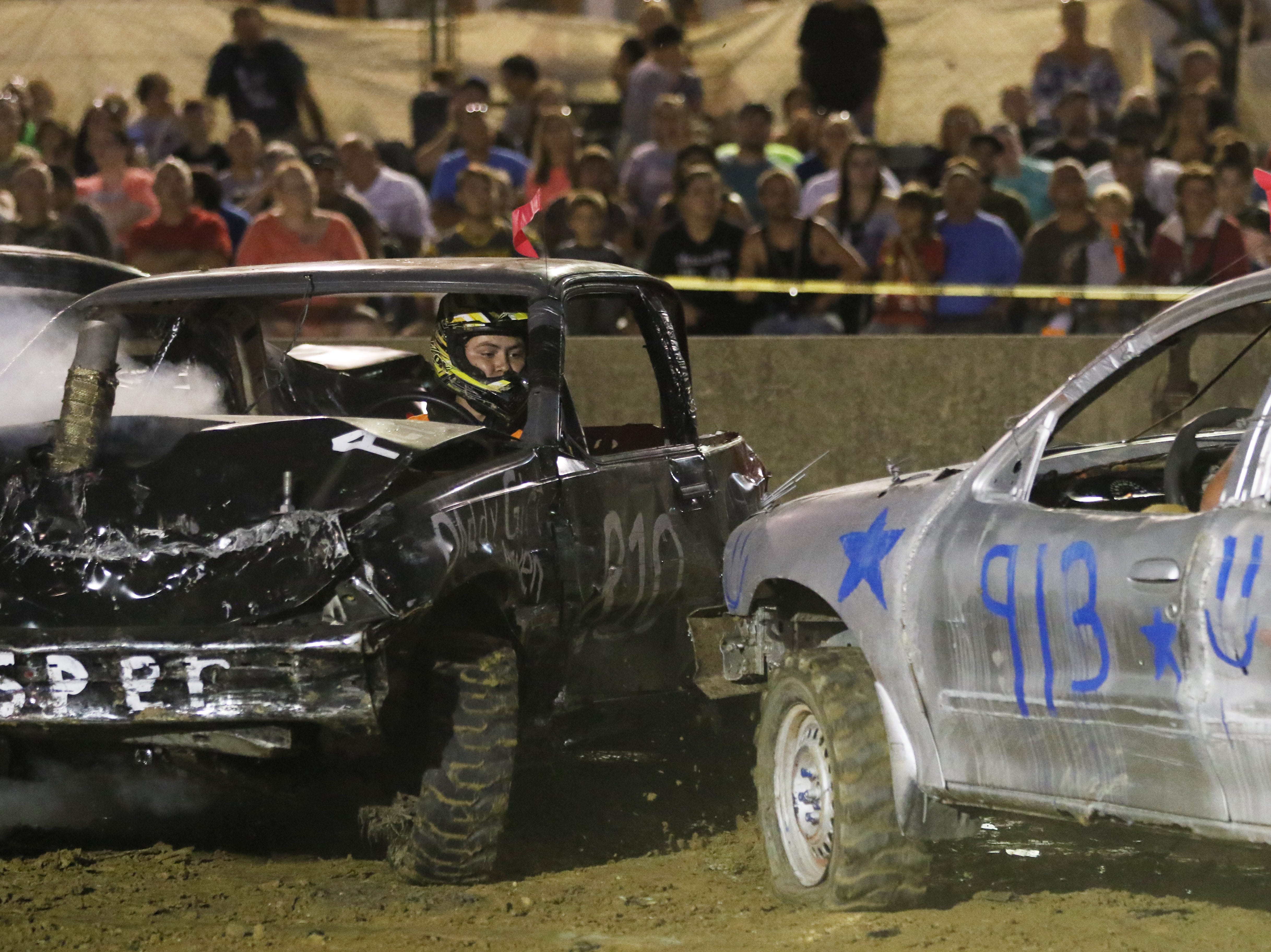 Robert Anderson gets hit by Brian Paul during the Sarge and Sons Demolition Derby at the Muskingum County Fair on Tuesday.