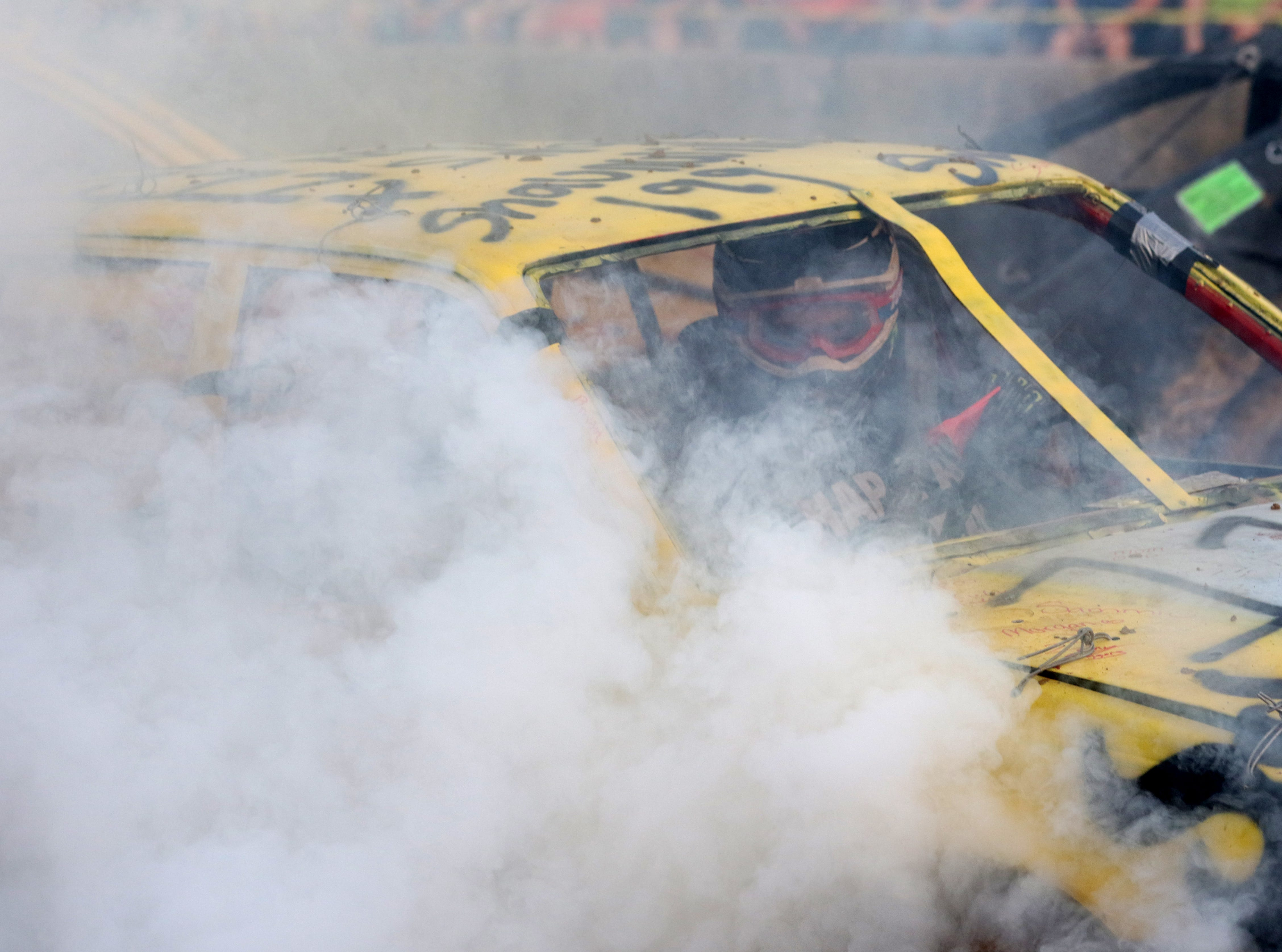 Shawn Savage finds himself in a fog during the Sarge and Sons Demolition Derby at the Muskingum County Fair on Tuesday.