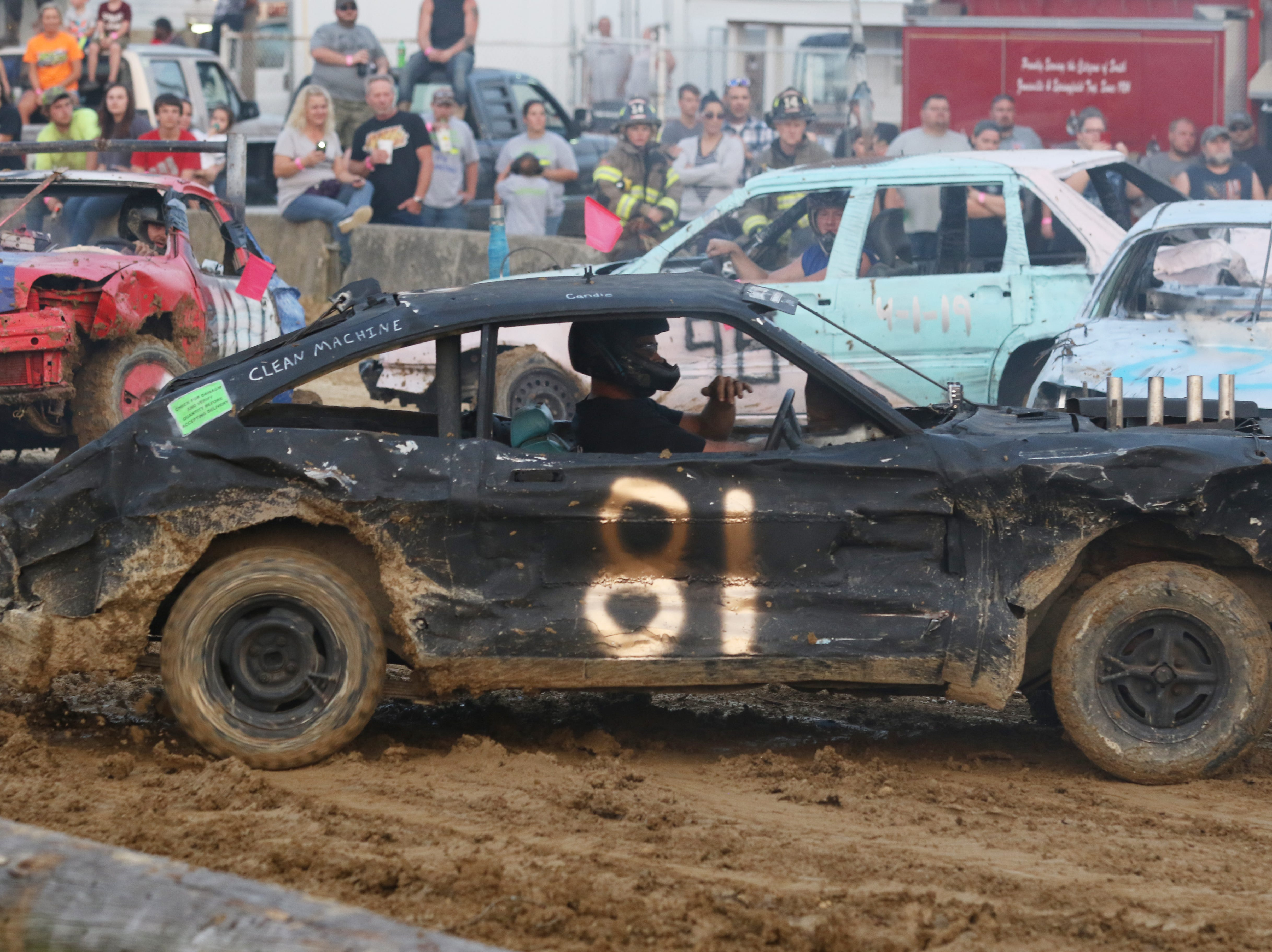 Dusty Dady races in his final demolition derby during the Sarge and Sons Demolition Derby at the Muskingum County Fair on Tuesday.