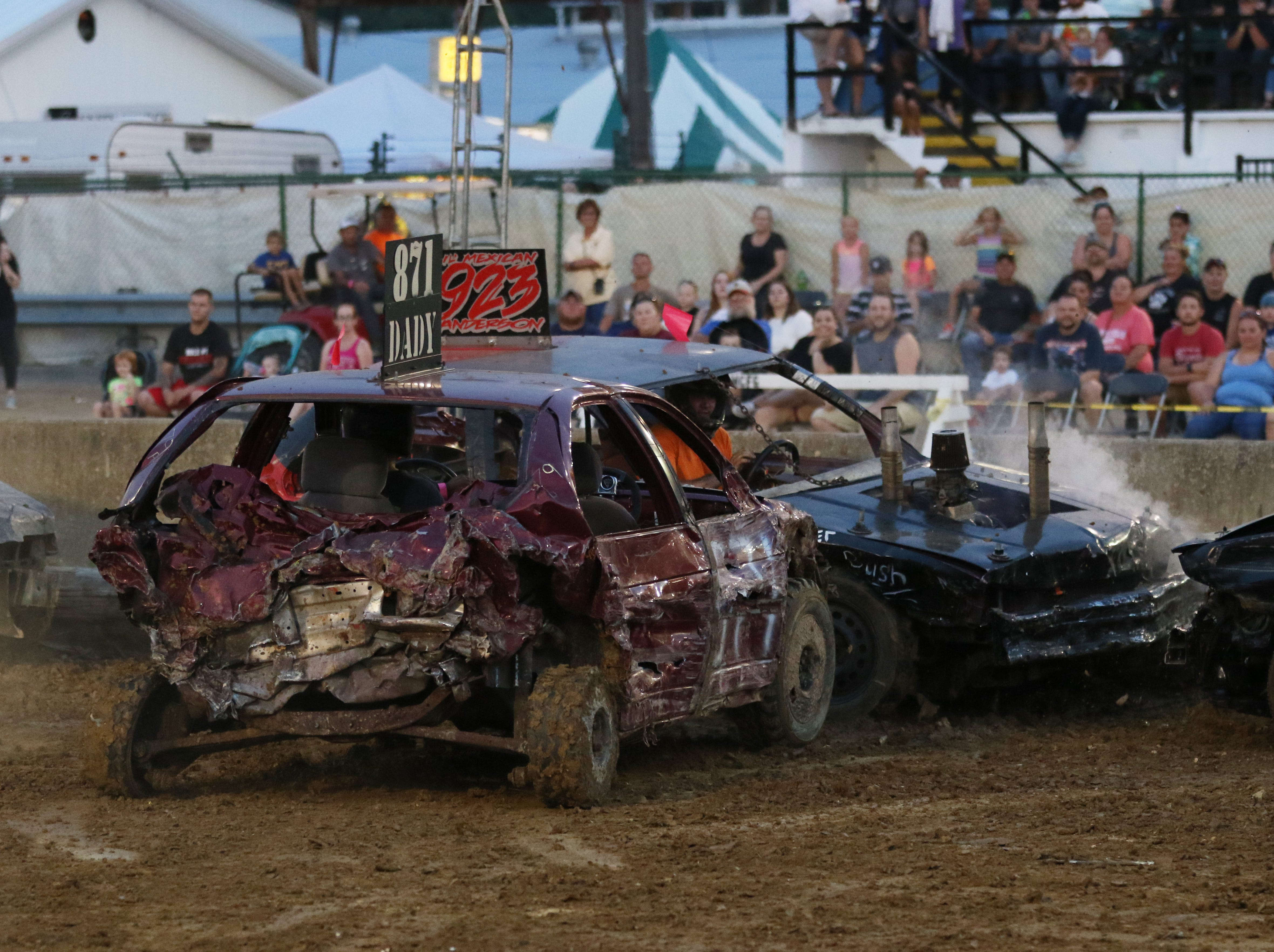 Jim Dady and Aaron Anderson battle to the end of the second heat of the Sarge and Sons Demolition Derby at the Muskingum County Fair on Tuesday.