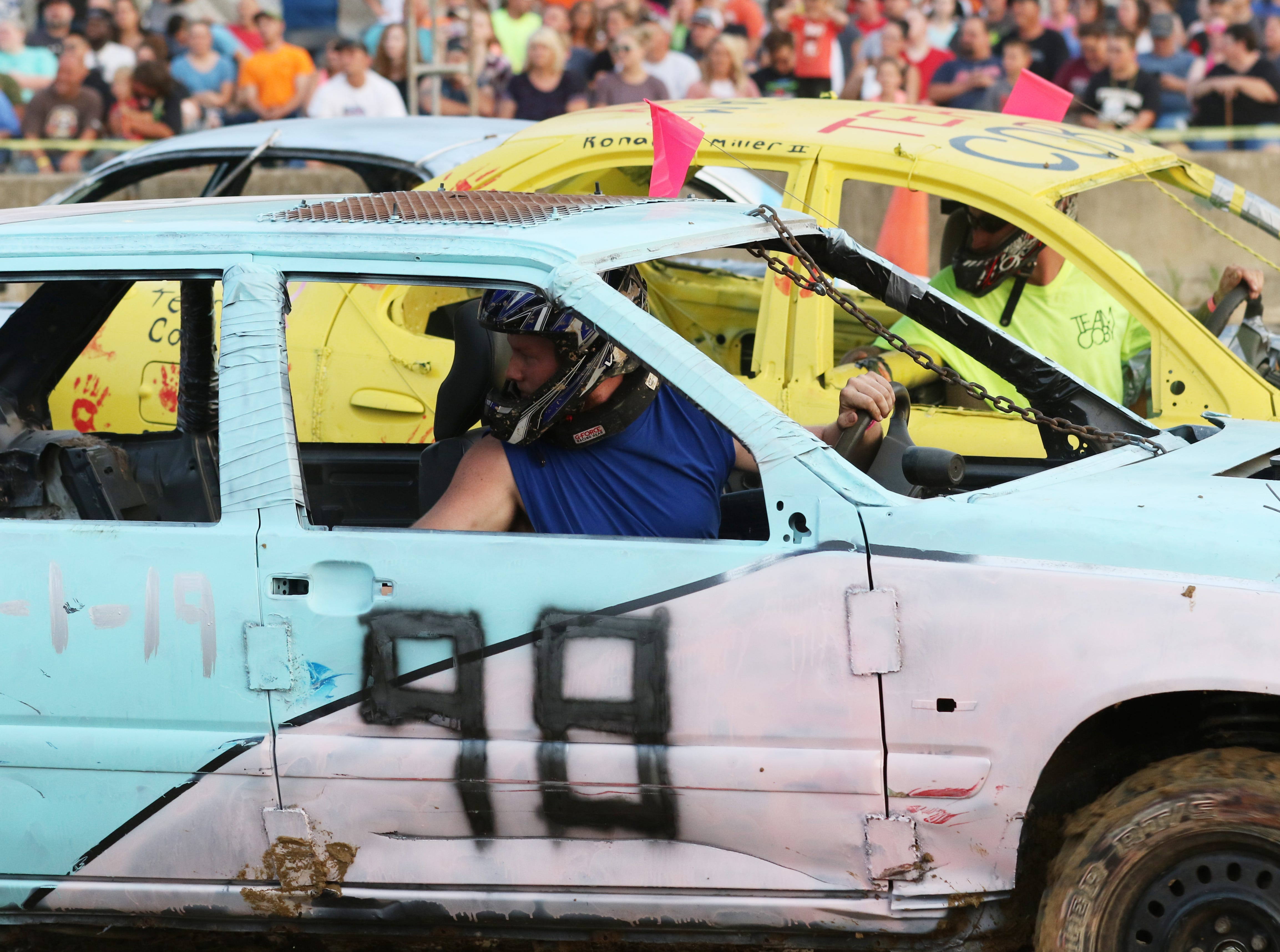 Patrick Bush in his 97 Volvo takes aim during the Sarge and Sons Demolition Derby at the Muskingum County Fair on Tuesday.