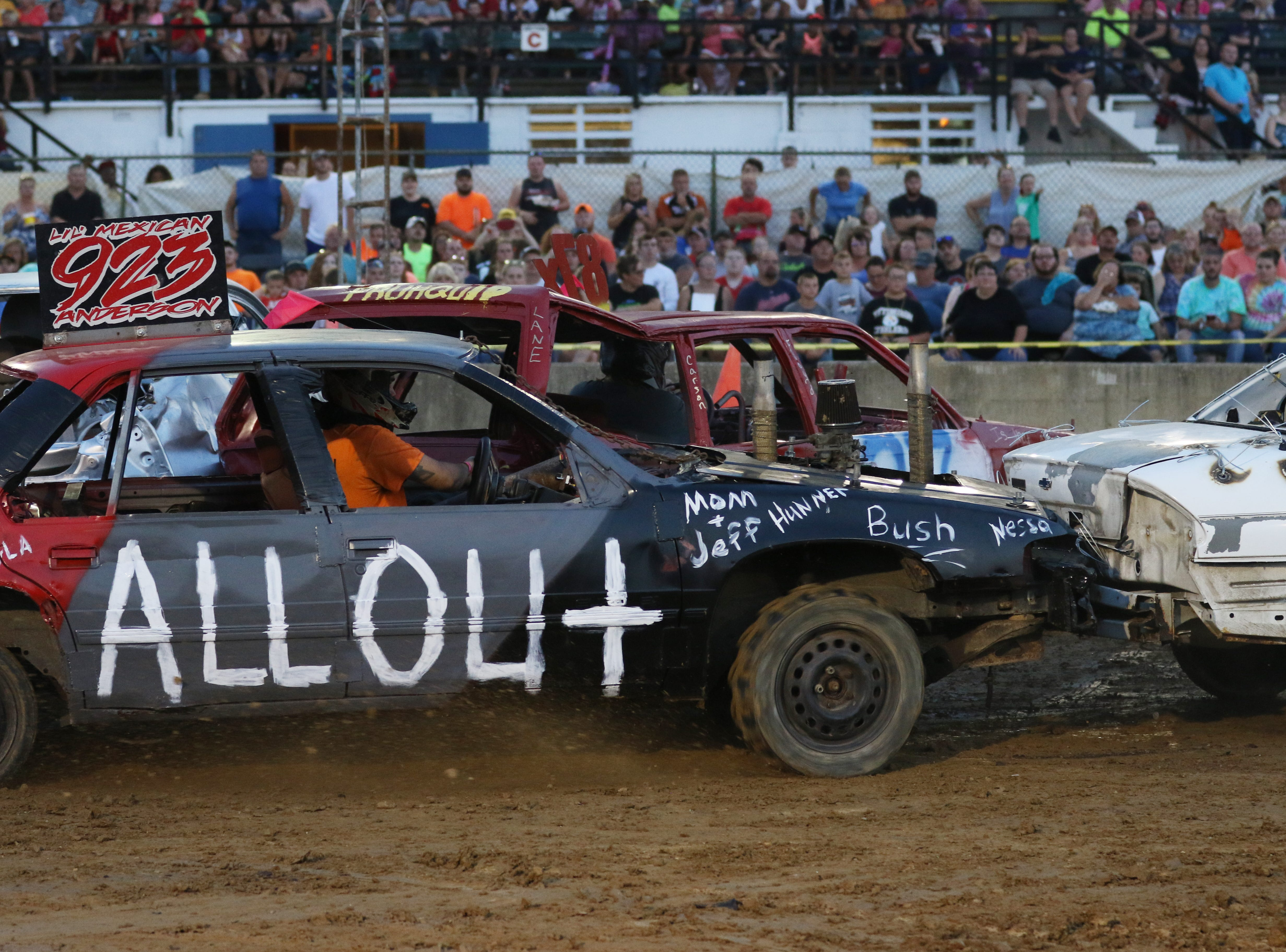 Aaron Anderson hits a car during the Sarge and Sons Demolition Derby at the Muskingum County Fair on Tuesday.