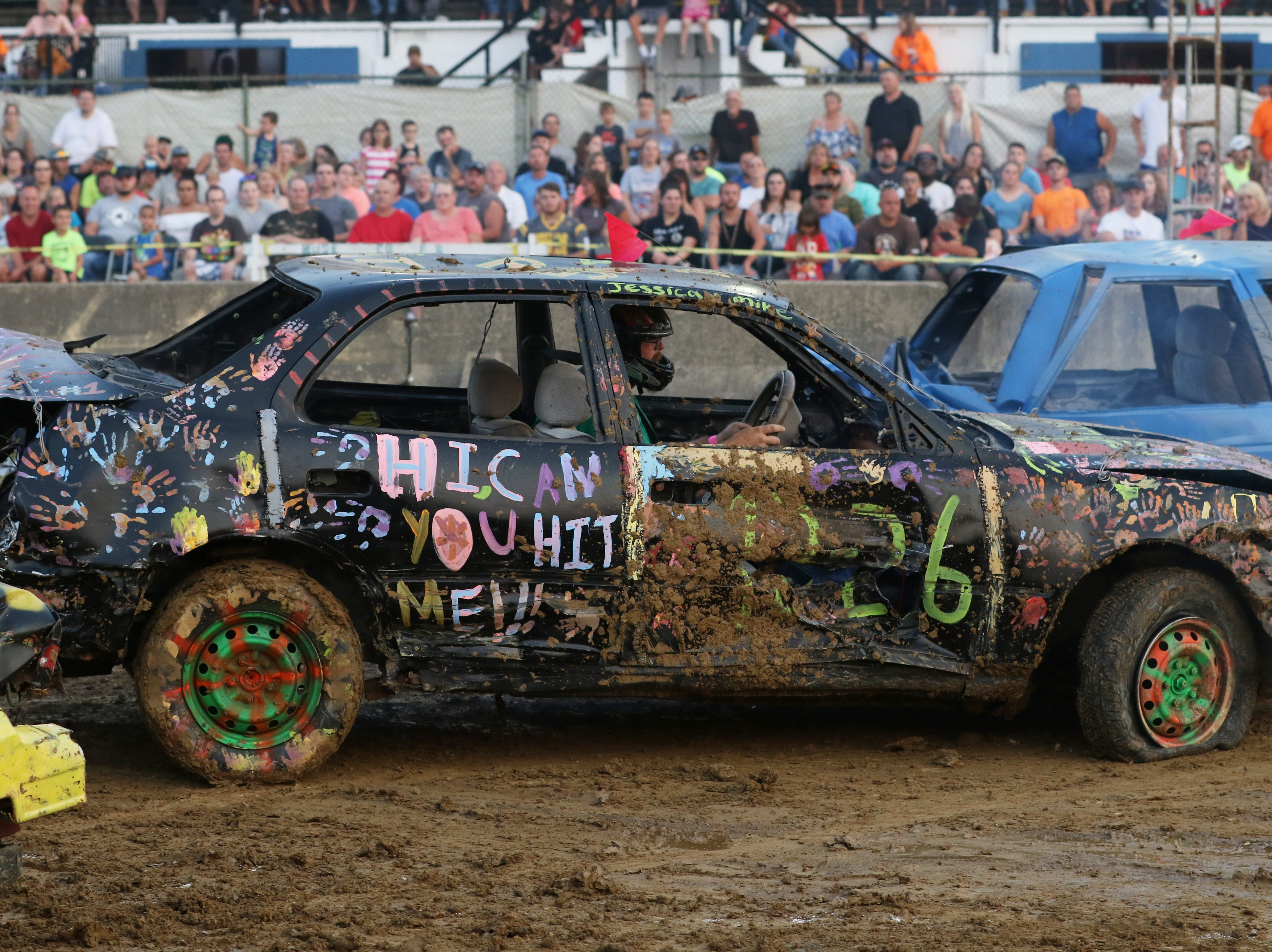 Jimmy Gibson his in 1226 car during the Sarge and Sons Demolition Derby at the Muskingum County Fair on Tuesday.