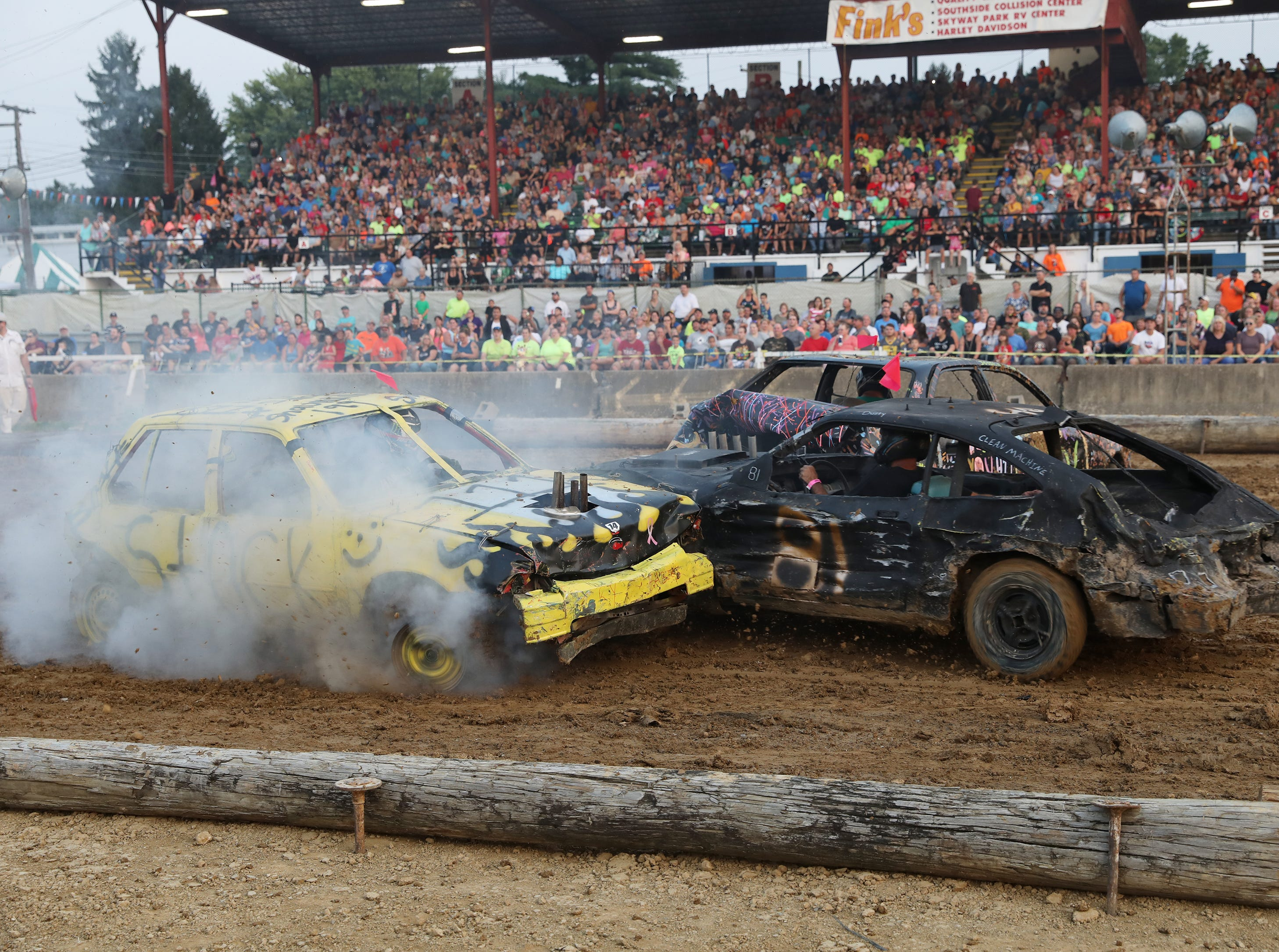 Dusty Dady and Shawn Savage collide during the Sarge and Sons Demolition Derby at the Muskingum County Fair on Tuesday.