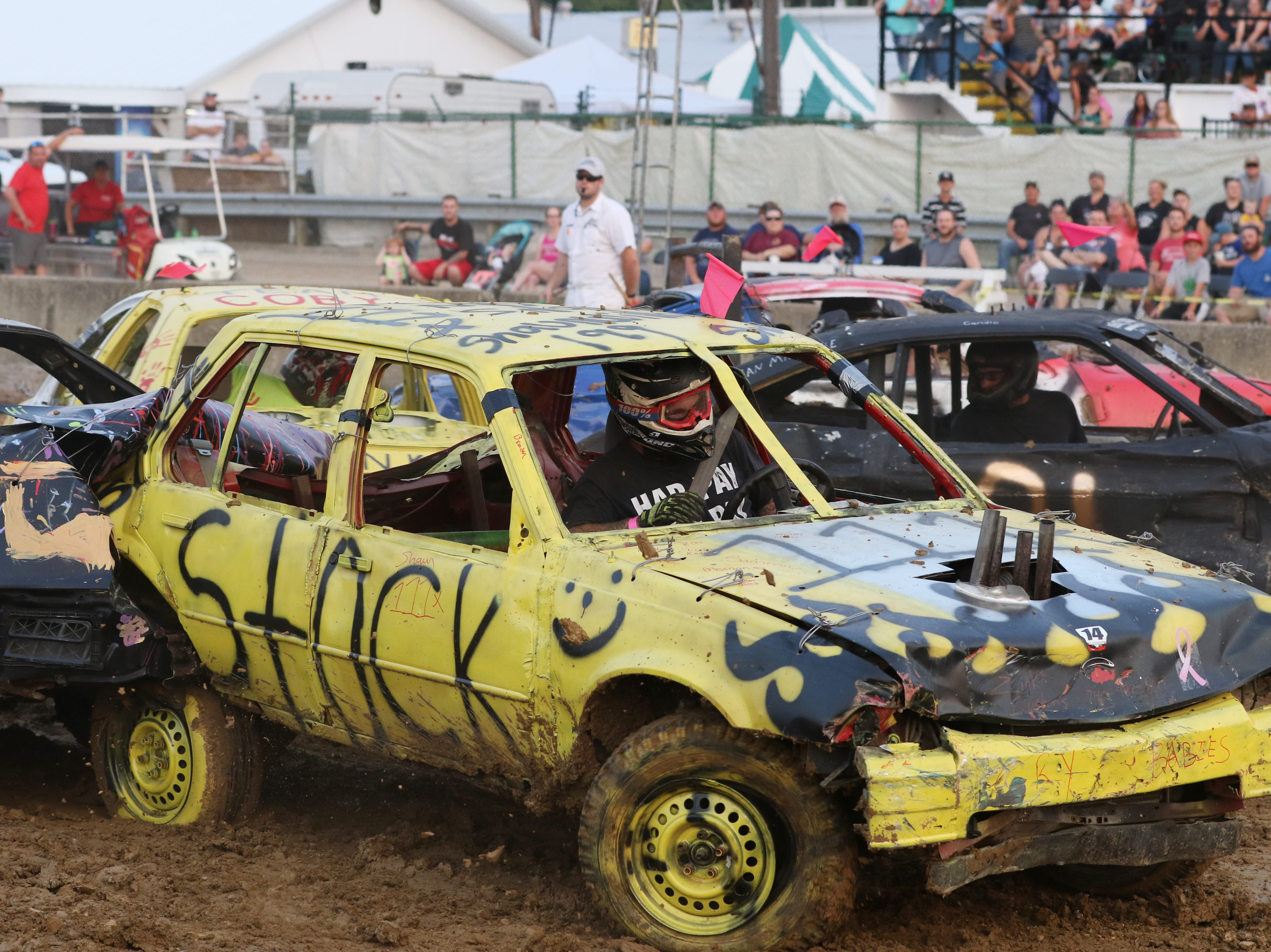 Cars collide during the Sarge and Sons Demolition Derby at the Muskingum County Fair on Tuesday.