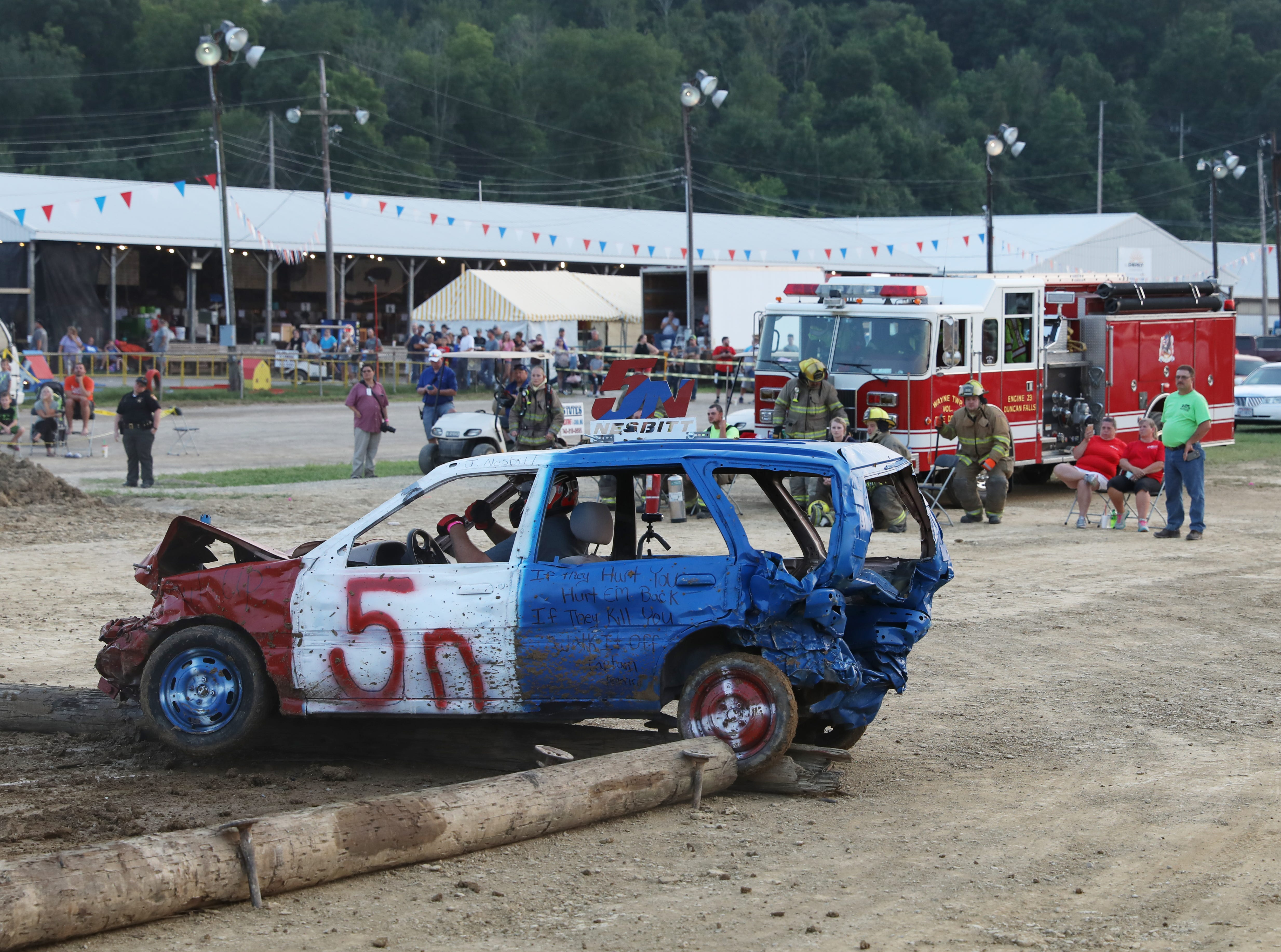 Ronald Miller's 2002 Chevy gets hung up during the Sarge and Sons Demolition Derby at the Muskingum County Fair on Tuesday.