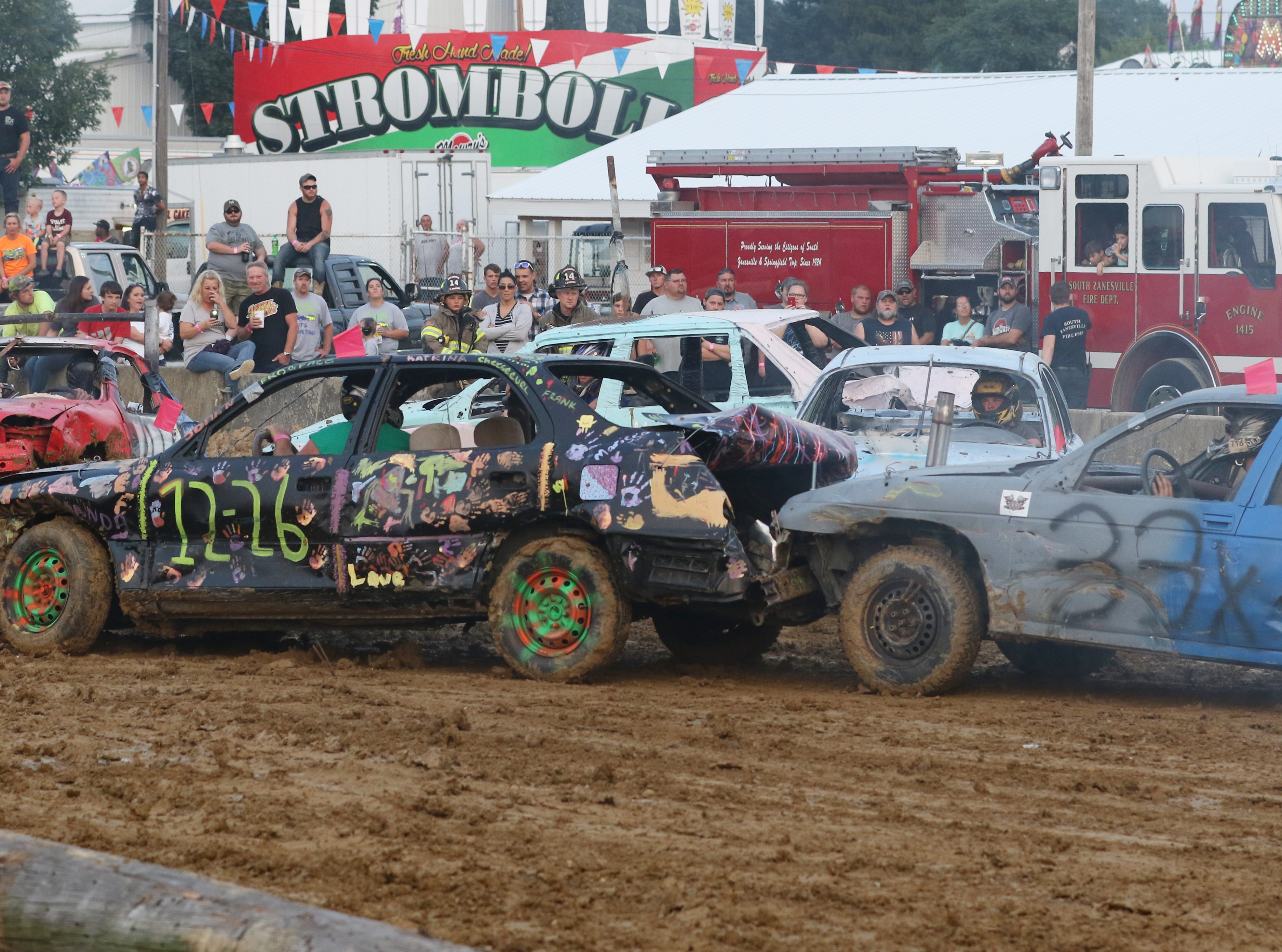 Jimmy Gibson meets Scott Cordle in his 33x car during the Sarge and Sons Demolition Derby at the Muskingum County Fair on Tuesday.