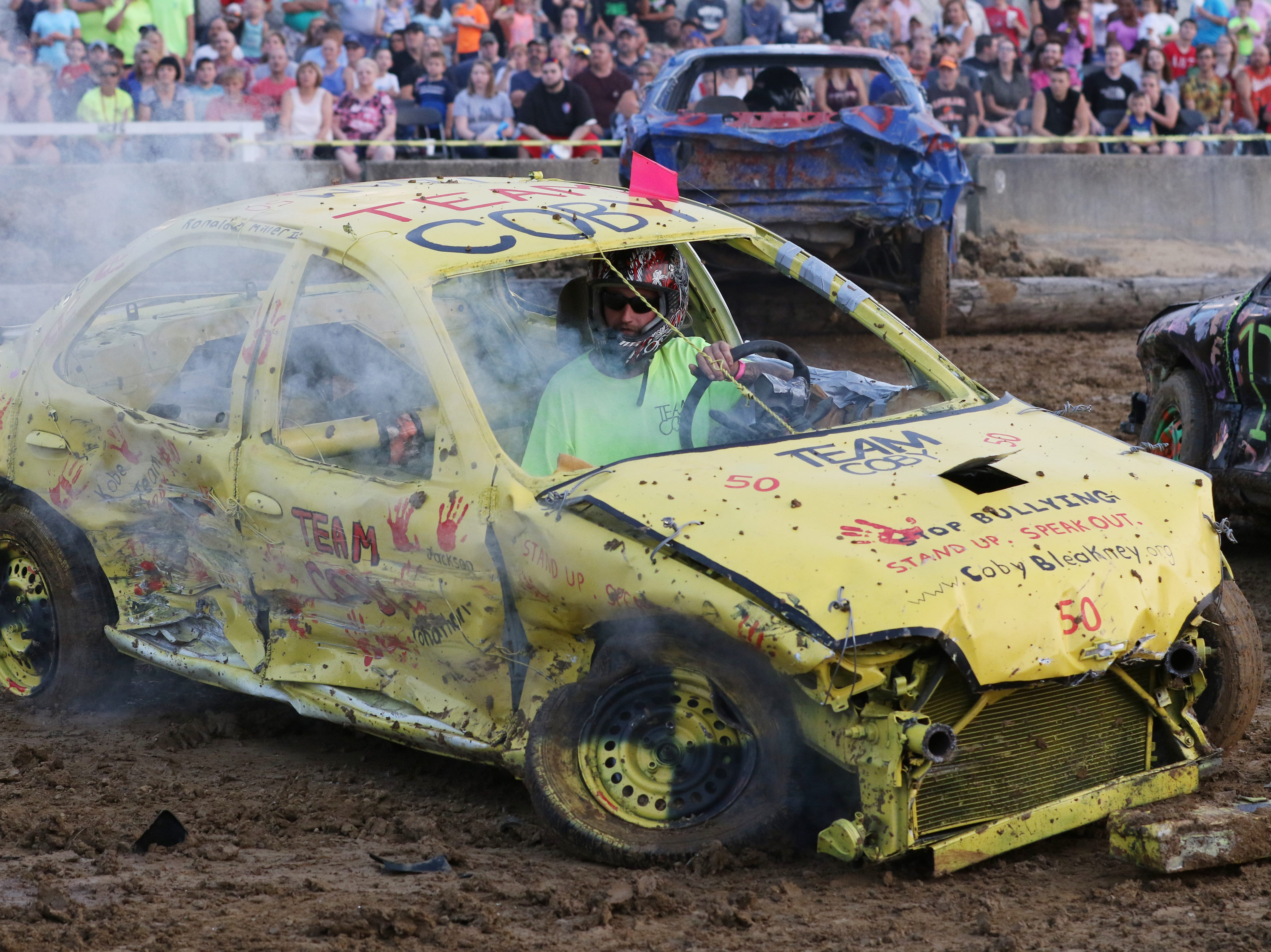 Ronald Miller is hit and left steaming during the Sarge and Sons Demolition Derby at the Muskingum County Fair on Tuesday.