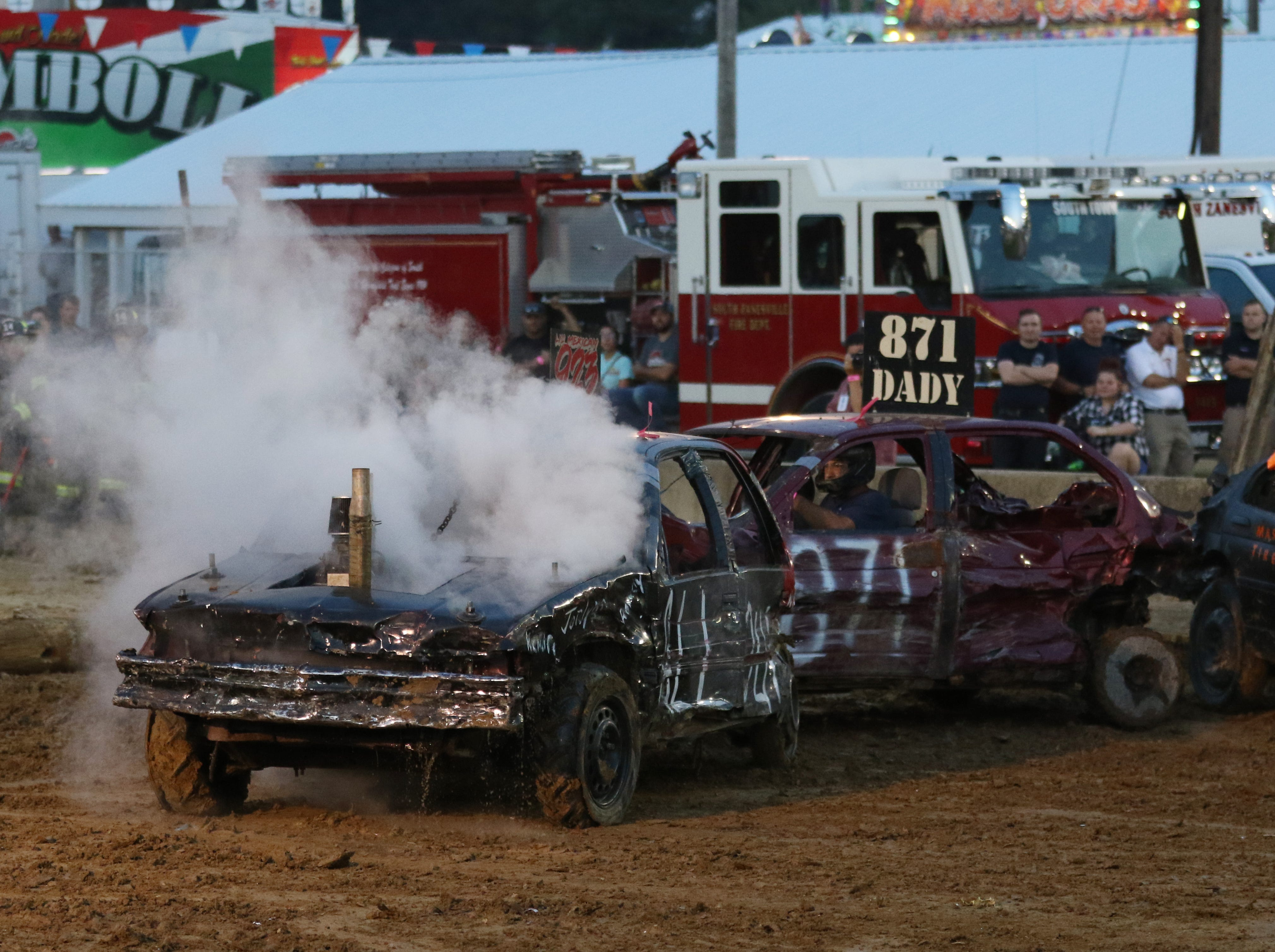 A car smokes during the Sarge and Sons Demolition Derby at the Muskingum County Fair on Tuesday.