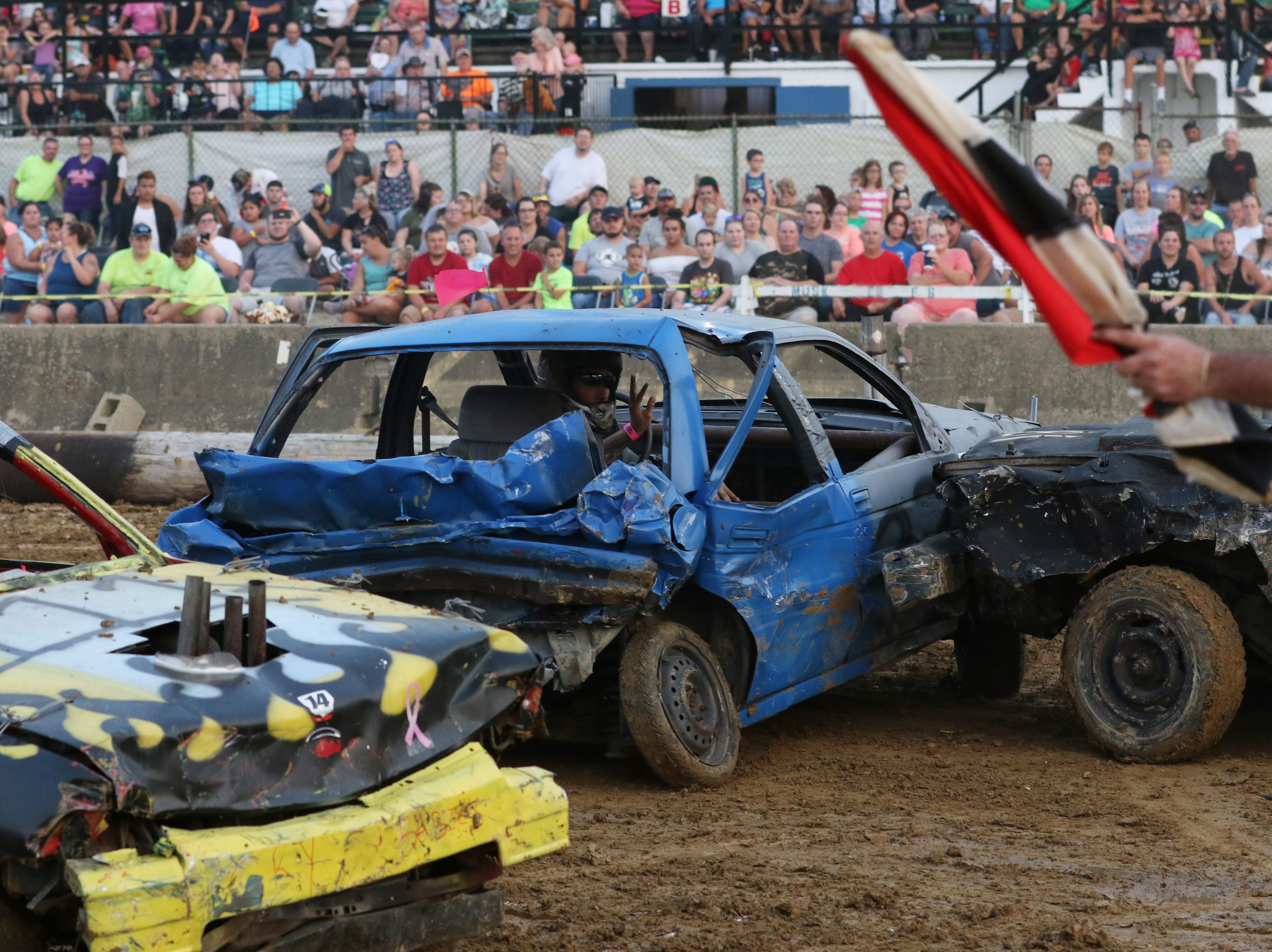 Scott Cordle gets hit during the Sarge and Sons Demolition Derby at the Muskingum County Fair on Tuesday.